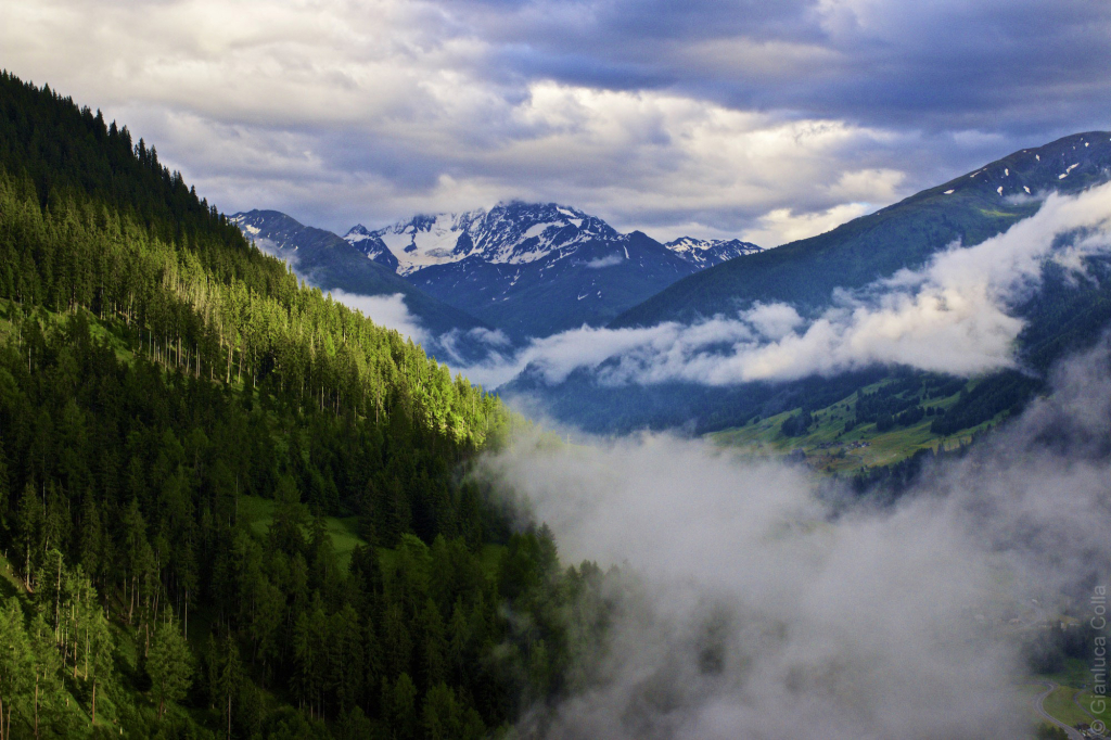 Clouds in a valley near the Italian border, in Switzerland.